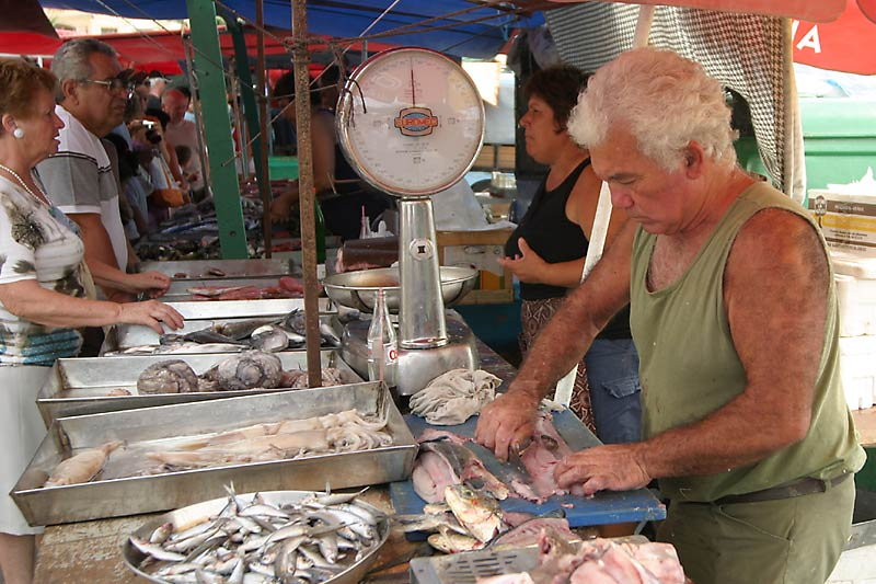 Fisherman Filleting Fish